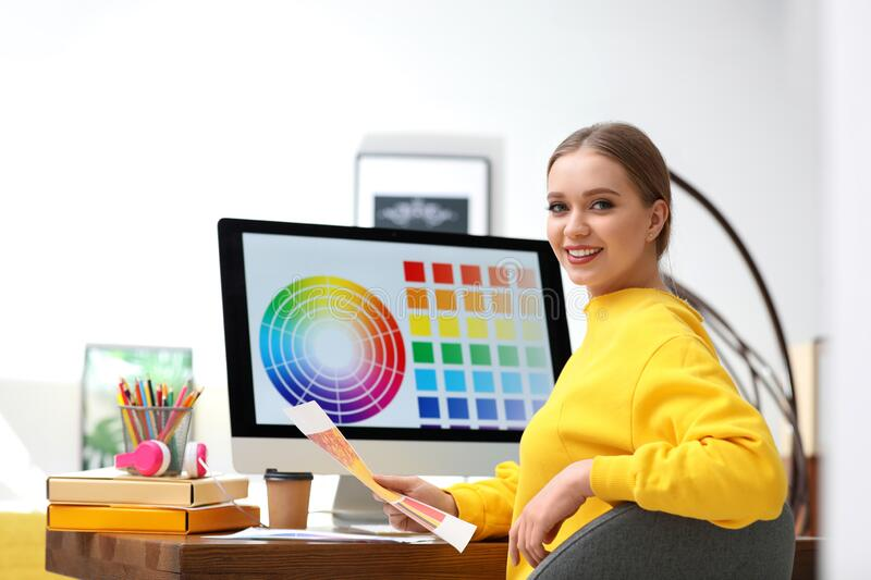 Professional designer with color palettes at workplace. In office royalty free stock photos