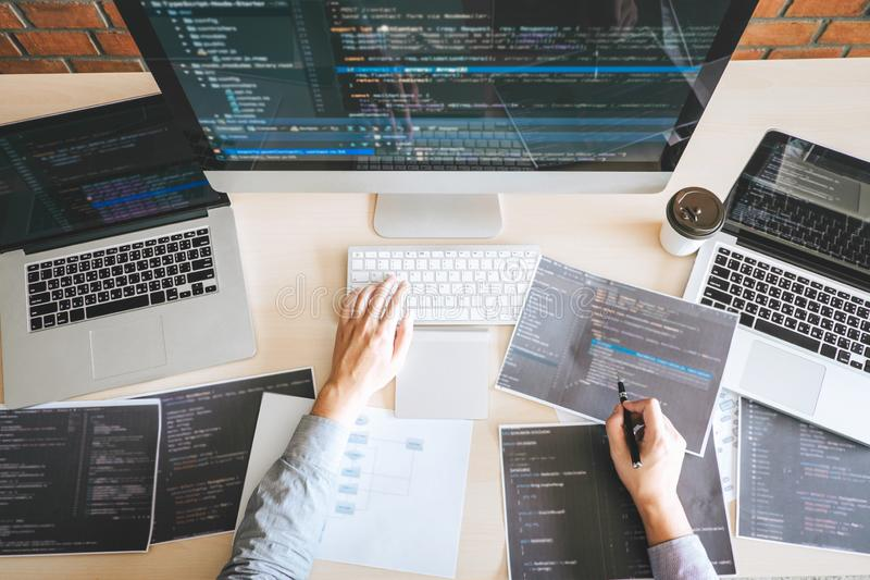 Professional Developer programmer working a software website design and coding technology, writing codes and database in company. Office, Global cyber stock images