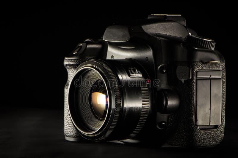 professional digital photo camera against black background royalty free stock image