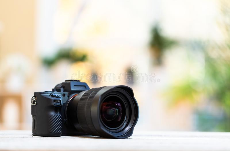 Professional digital SLR camera on a bright background royalty free stock photography