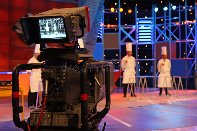 Professional digital video camera. Television studio inside the video camera is shooting TV show royalty free stock photo