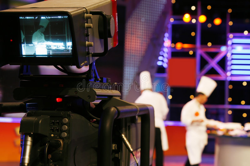 Professional digital video camera. Television studio inside the video camera is shooting TV show stock image