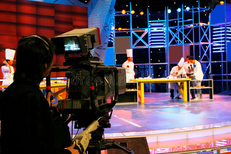Professional digital video camera. Television studio inside the video camera is shooting TV show royalty free stock photography