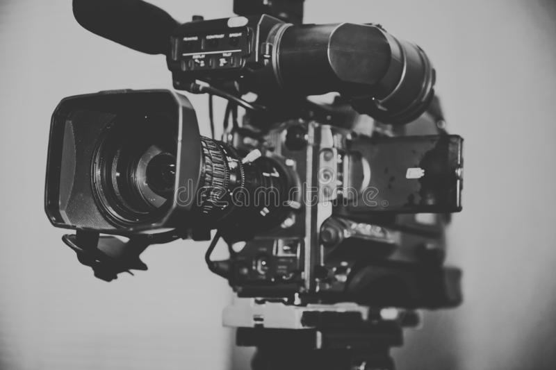 Professional digital video camera. accessories for 4k video cameras. tv camera in a concert hall. Video camera lens - recording sh royalty free stock photo