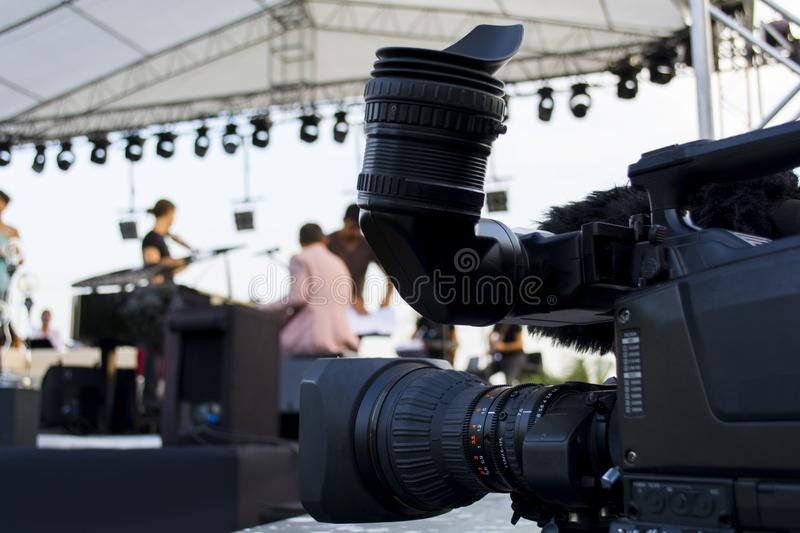 Professional digital video camera. accessories for 4k video cameras. tv camera in a concert hall. stock image