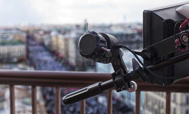 Professional digital video camera. Professional camcorder on the shooting of the cityscape royalty free stock images