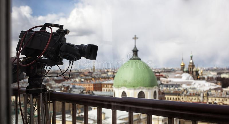 Professional digital video camera. Professional camcorder on the shooting of the cityscape stock photography