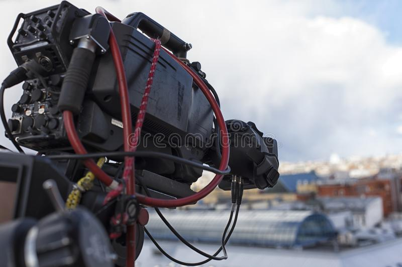 Professional digital video camera. Professional camcorder on the shooting of the cityscape royalty free stock photo