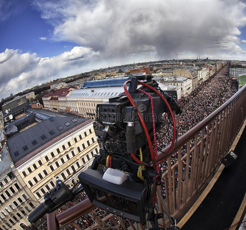 Professional digital video camera. Professional camcorder on the shooting of the cityscape stock photo