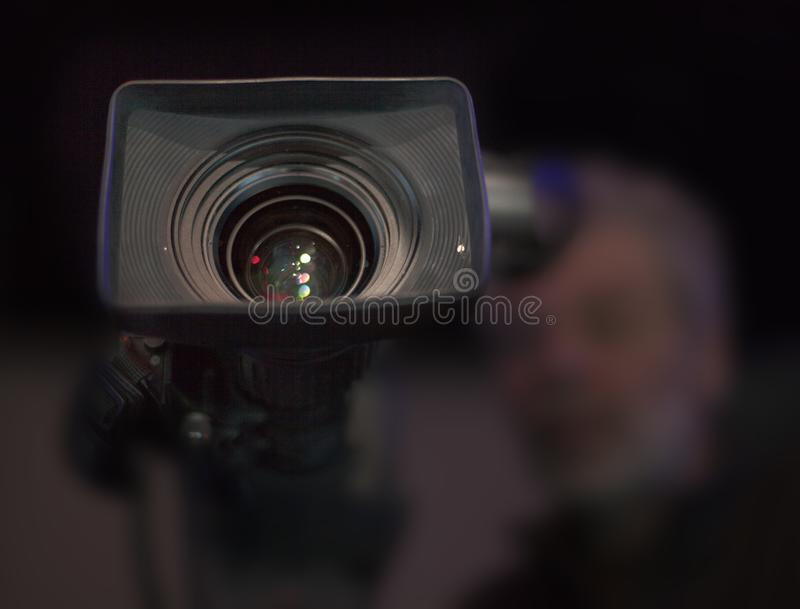Professional digital video camera. A professional video camera, cinematography in the pavilion royalty free stock images