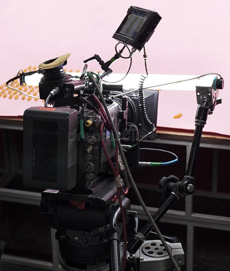 Professional digital video camera. A professional video camera, cinematography in the pavilion royalty free stock image
