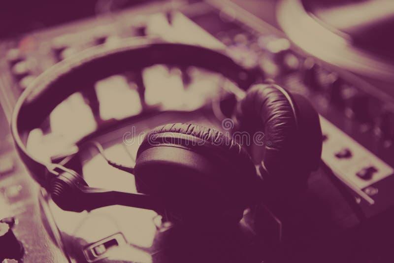 Professional dj headphones on sound mixer in club royalty free stock photos