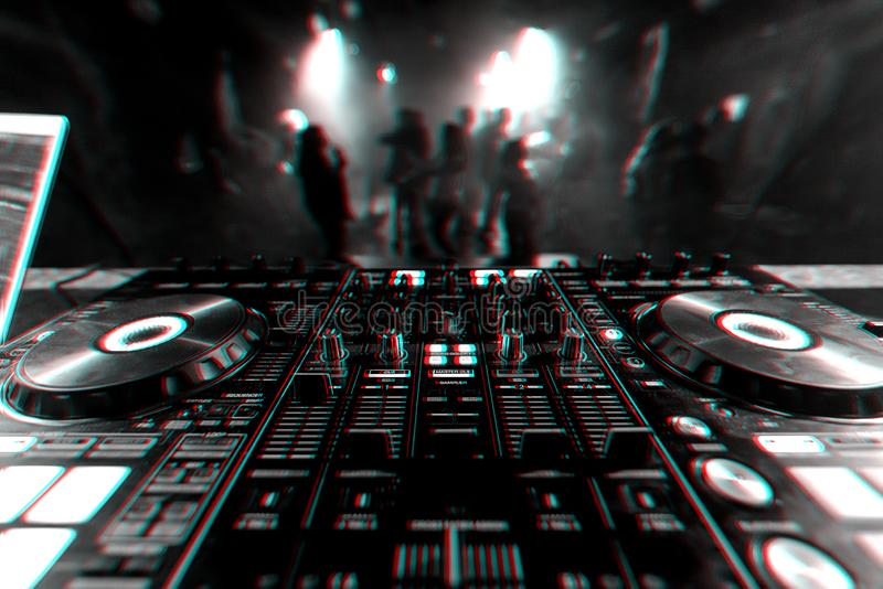 Professional DJ mixer controller for mixing music in a nightclub. With dancing people on the dance floor. Black and white photo with glitch effect and small royalty free stock photos