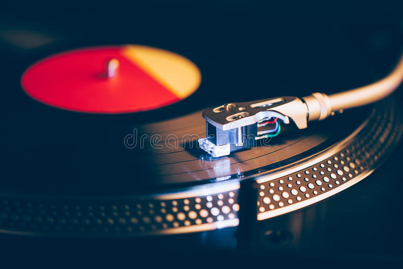 Professional dj turntable with illumination. Dark background stock images