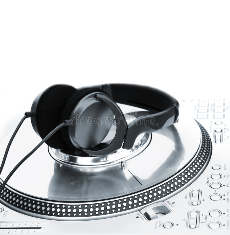 Professional DJ Vinyl Player. With green Headphones on it royalty free stock photos