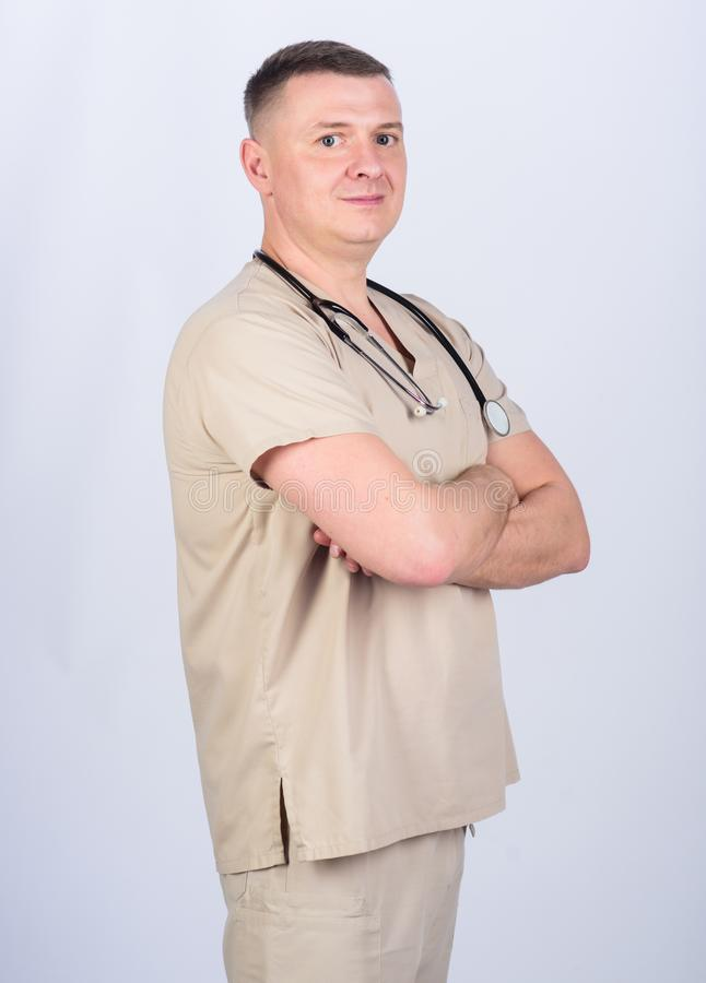 Professional doctor. Experienced doctor beige clothes on white background. Private clinic. Check health. Doctor career. Man doctor with stethoscope physician stock photography