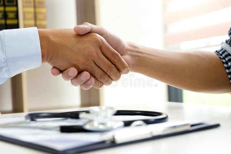 Professional doctor handshake to the patient. After they have good advice for the good health royalty free stock photo