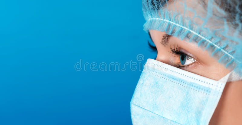 Professional doctor at work blue background royalty free stock photos