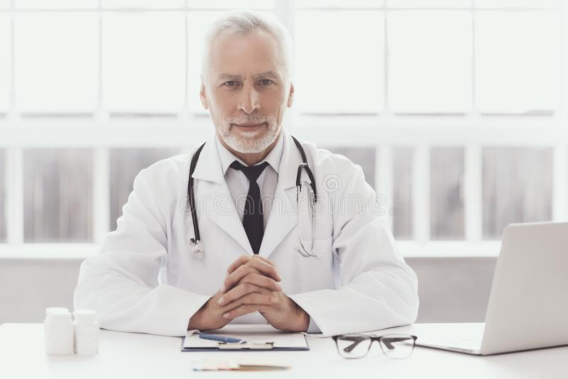 Professional Doctor Working in Medical Office stock images