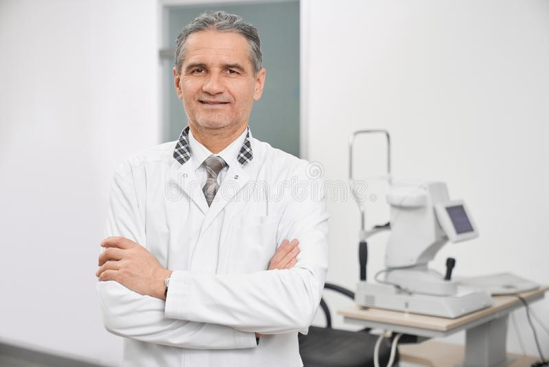 Professional doctort posing in medical room of clinic. royalty free stock photography