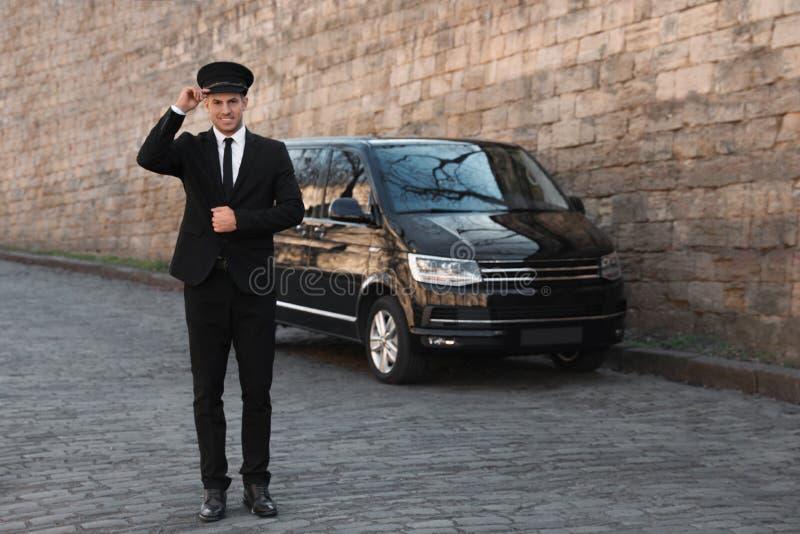 Professional driver near car on street. Chauffeur service. Professional driver near luxury car on street. Chauffeur service royalty free stock photos