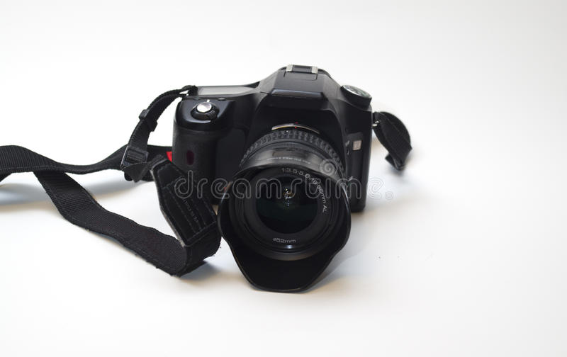Professional dslr camera with lens, lens hood and strap royalty free stock images