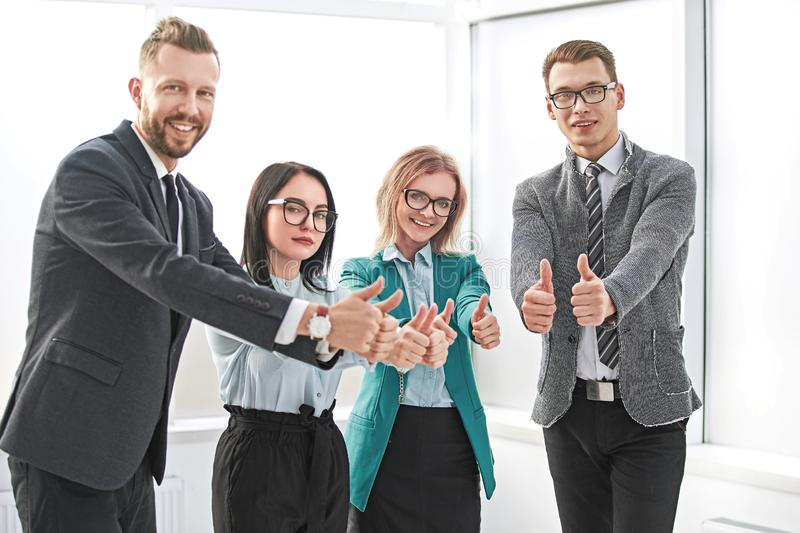 Professional employees of the company showing thumbs up. stock photography