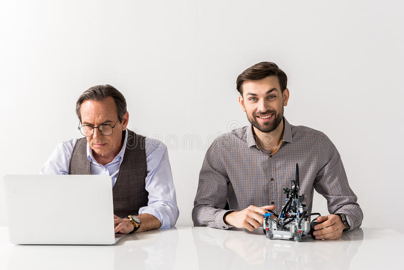 Professional engineers are working with pleasure royalty free stock photography
