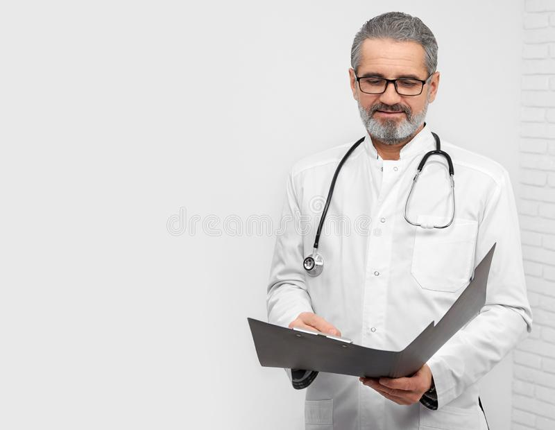 Professional ENT doctor posing with stethoscope on neck. royalty free stock images