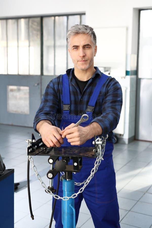 Professional equipment garage. Pneumatic - hydraulic jack gearbox. Car mechanic stock image