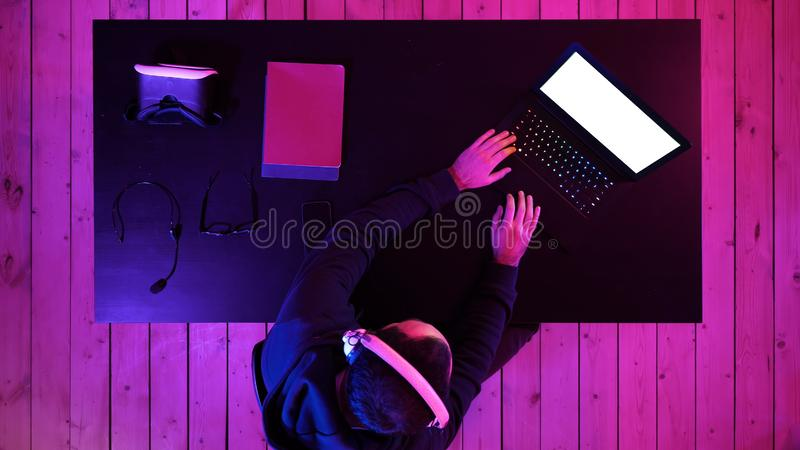 Professional eSport Gamer Playing. White Display. Top view. Professional eSport Gamer Playing. White Display. Professional shot in 4K resolution. 020. You can royalty free stock images