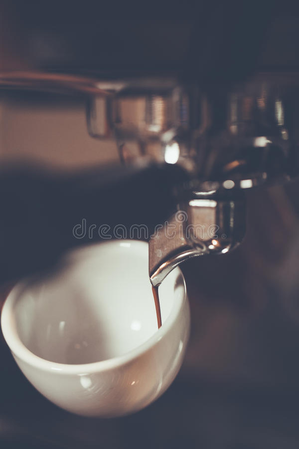 Professional espresso machine brewing a coffee. Coffee pouring i royalty free stock photography