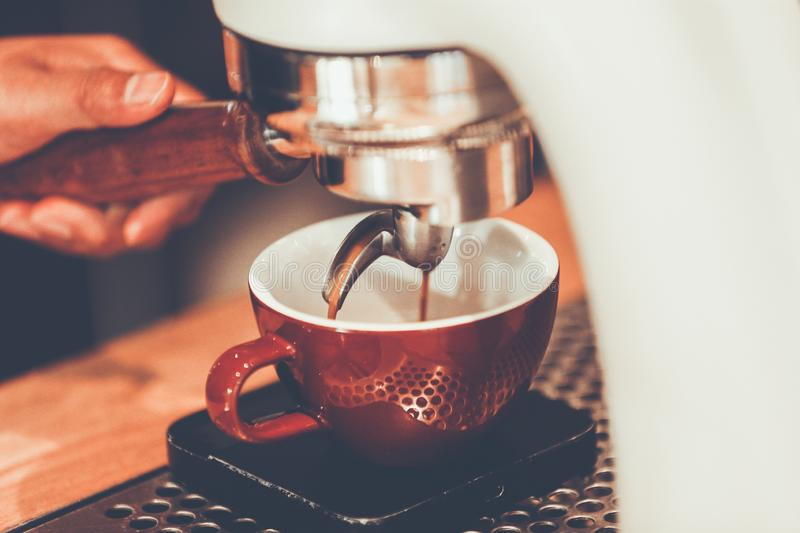 Professional espresso machine brewing a coffee. royalty free stock photography