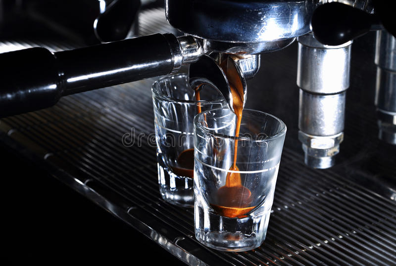 Professional espresso machine brewing a coffee stock photography