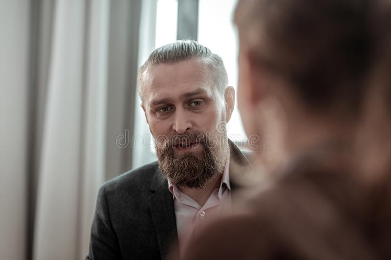 Professional experienced counselor talking to teenage girl. Experienced counselor. Close up of professional experienced counselor talking to teenager sharing her royalty free stock photo