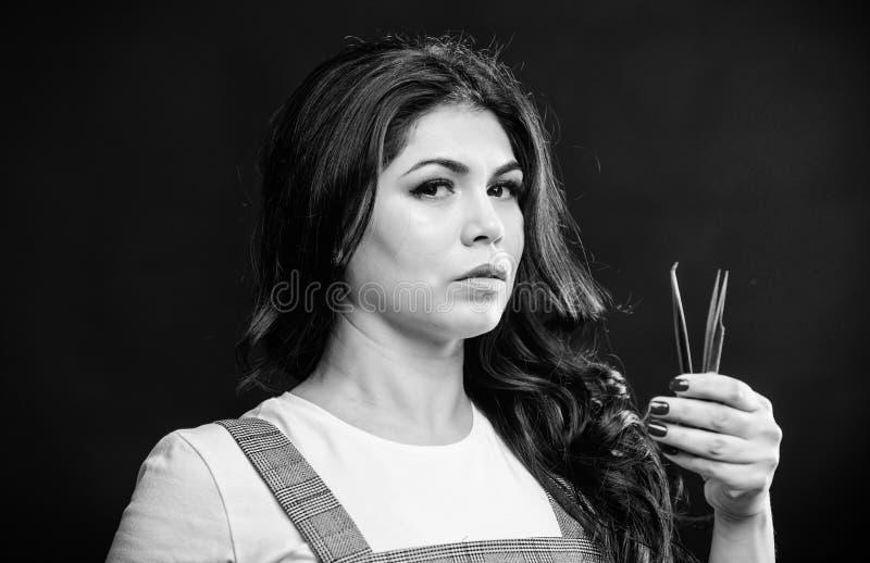 Professional eyelash extension tweezer. Makeup artist. Cosmetic tweezer. Girl makeup face hold tweezer for eyelash stock image