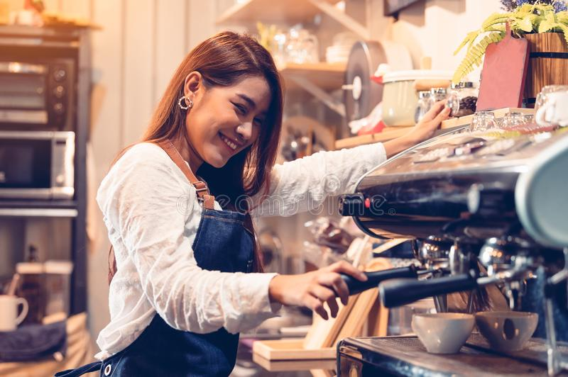 Professional female barista hand making cup of coffee with coffee maker machine in restaurant pub or coffee shop. People and. Lifestyles. Business food and royalty free stock photo