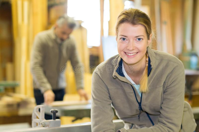 Professional female carpenter worker looking at camera. Woman royalty free stock image