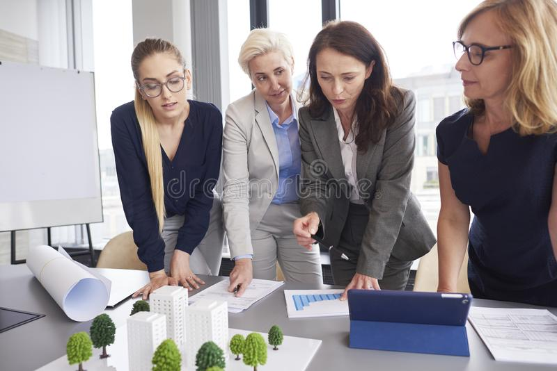 Professional female coworkers during business meeting stock image