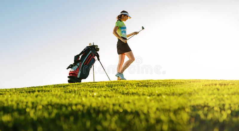 Professional female golfer on golf course royalty free stock images