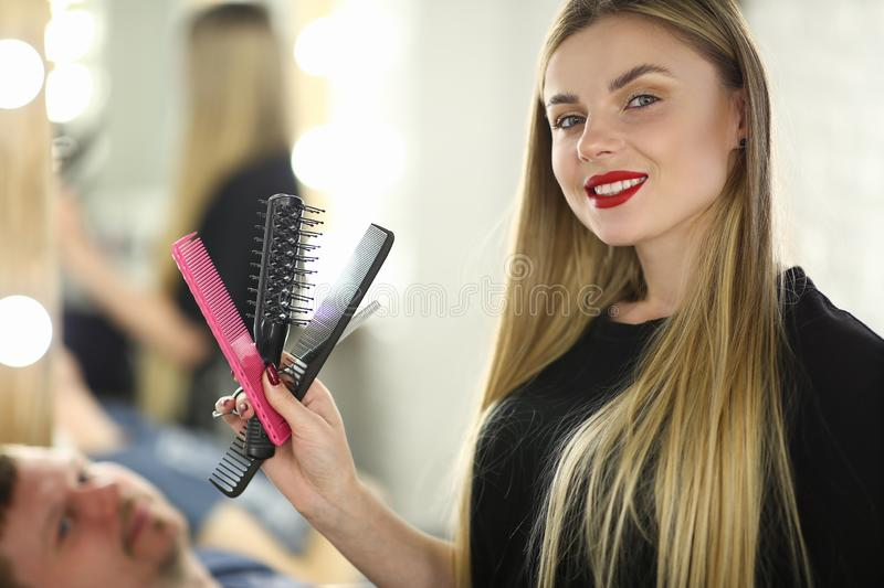 Professional Female Hairstylist with Hairbrush royalty free stock photo