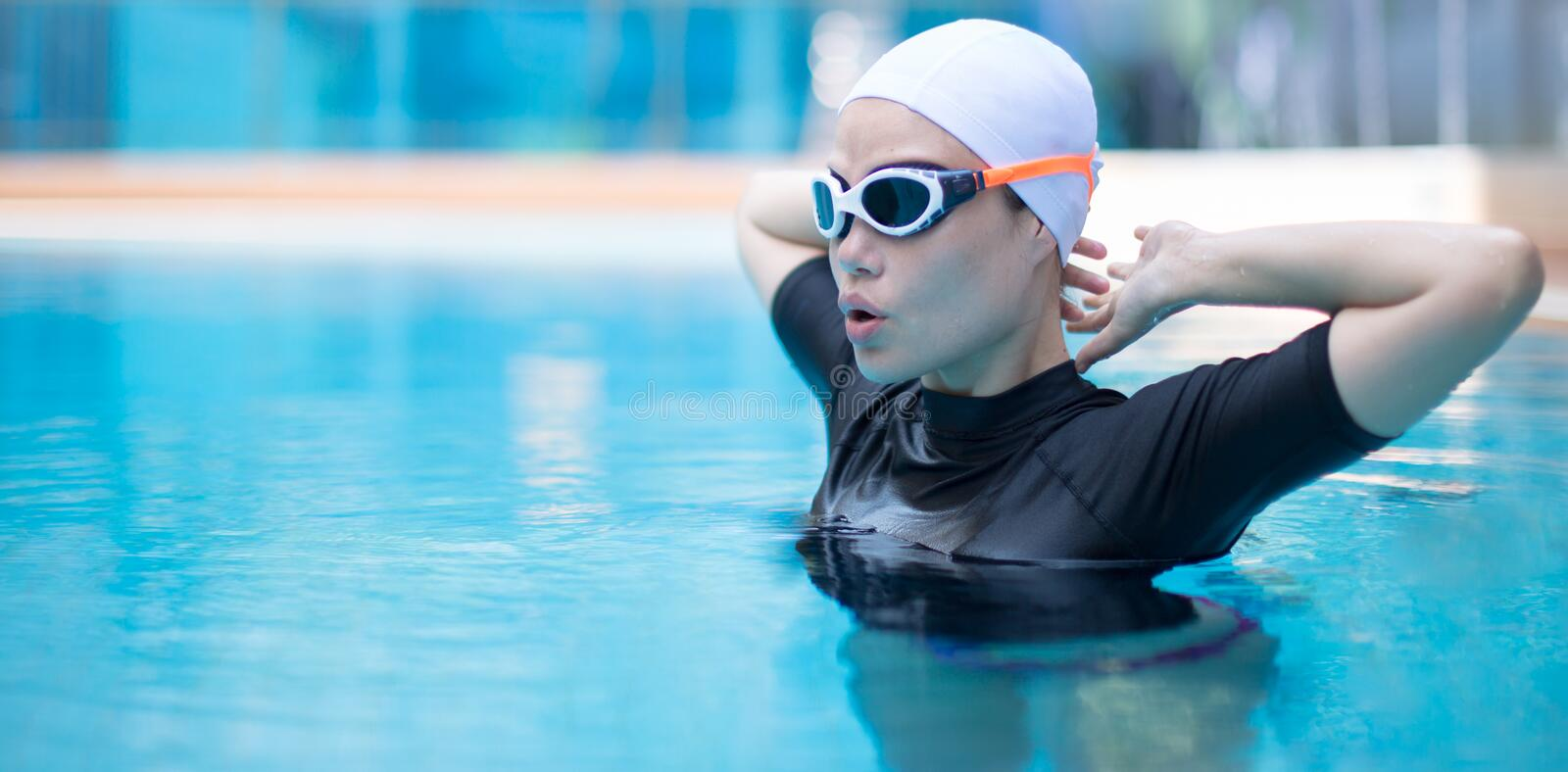 Professional female swimmer in the pool stock photo