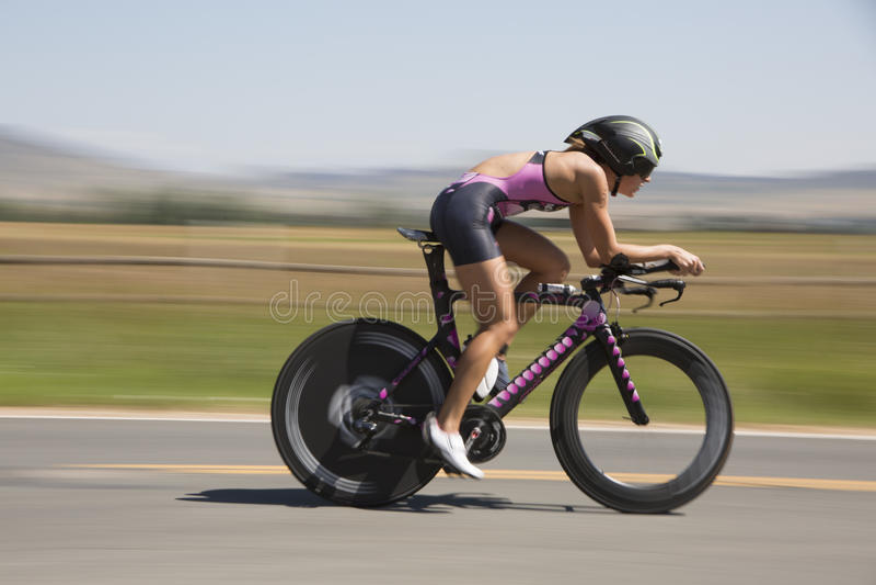 Professional Female Triathlon racer. Panning photo of Professional female triathlon racer . Boulder Triathlon . Boulder Colorado stock photos