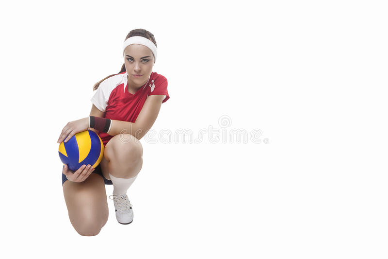 Professional Female Volleyball Player Sitting With Ball. Isolate royalty free stock photos