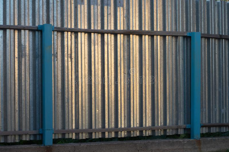 Professional fence. FENCING FROM METAL ON CONCRETE FOUNDATION royalty free stock image