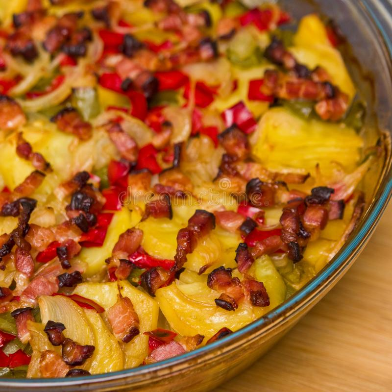 Elegant food photo of potato, pork and bacon baked dish royalty free stock photos