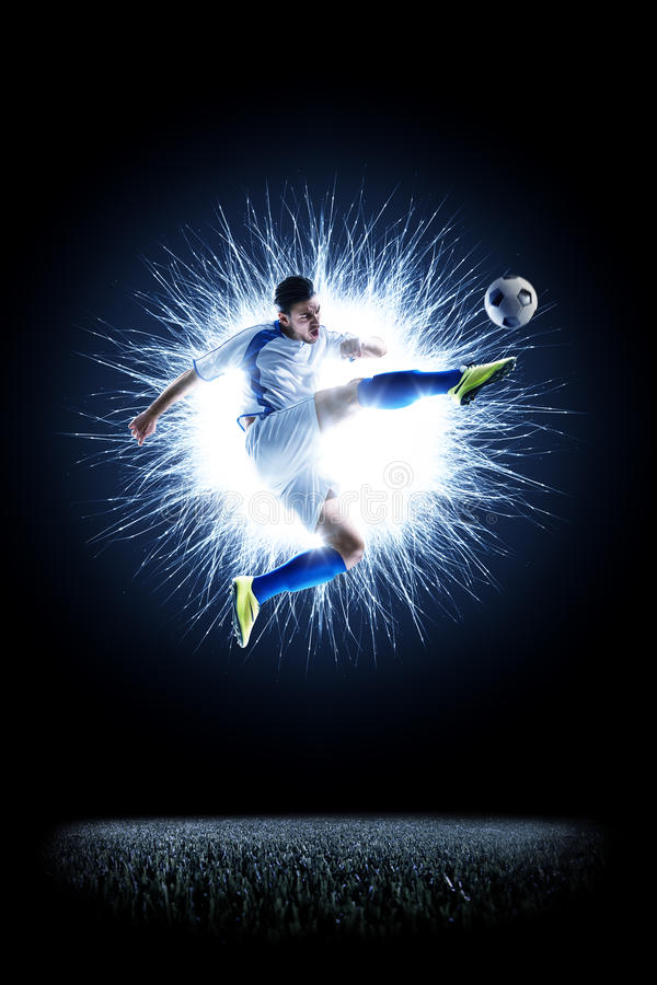 Professional football soccer player in action on black royalty free stock images