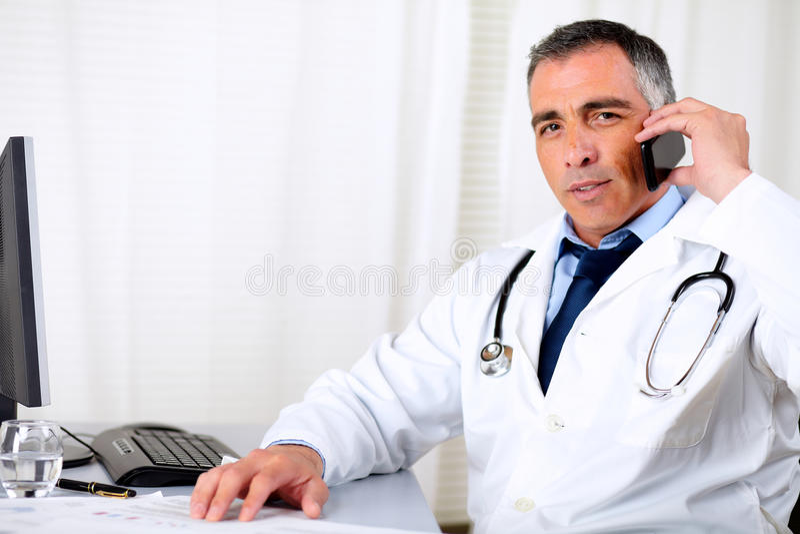 Professional friendly senior doctor royalty free stock photo