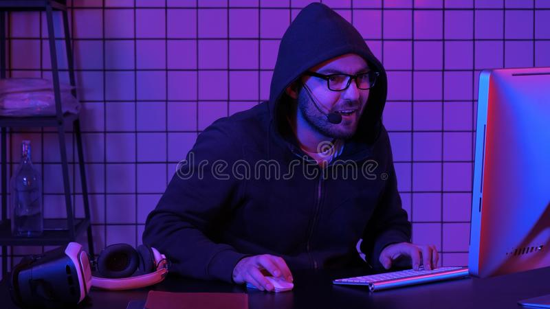 Professional Gamer Very Emotional Playing in Video Game and Streaming. royalty free stock photography