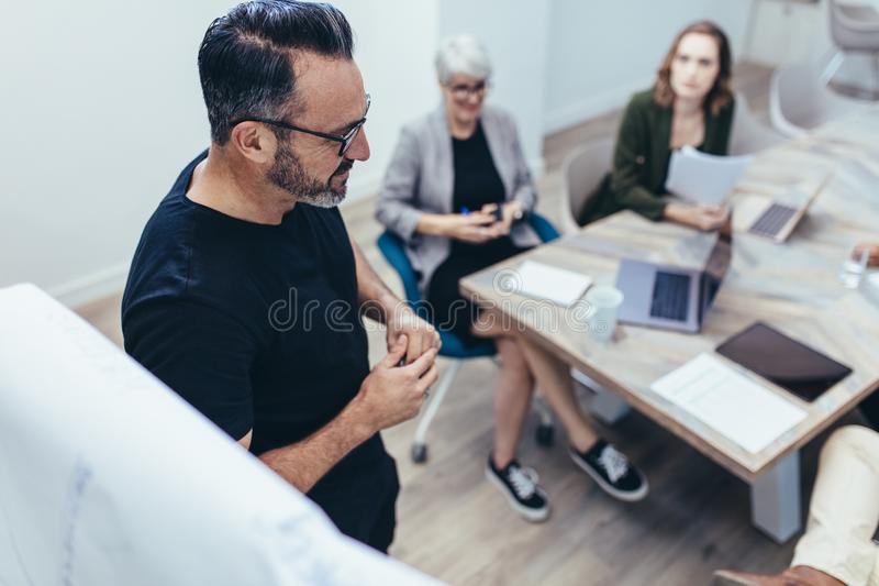 Professional giving presentation to his team royalty free stock photos